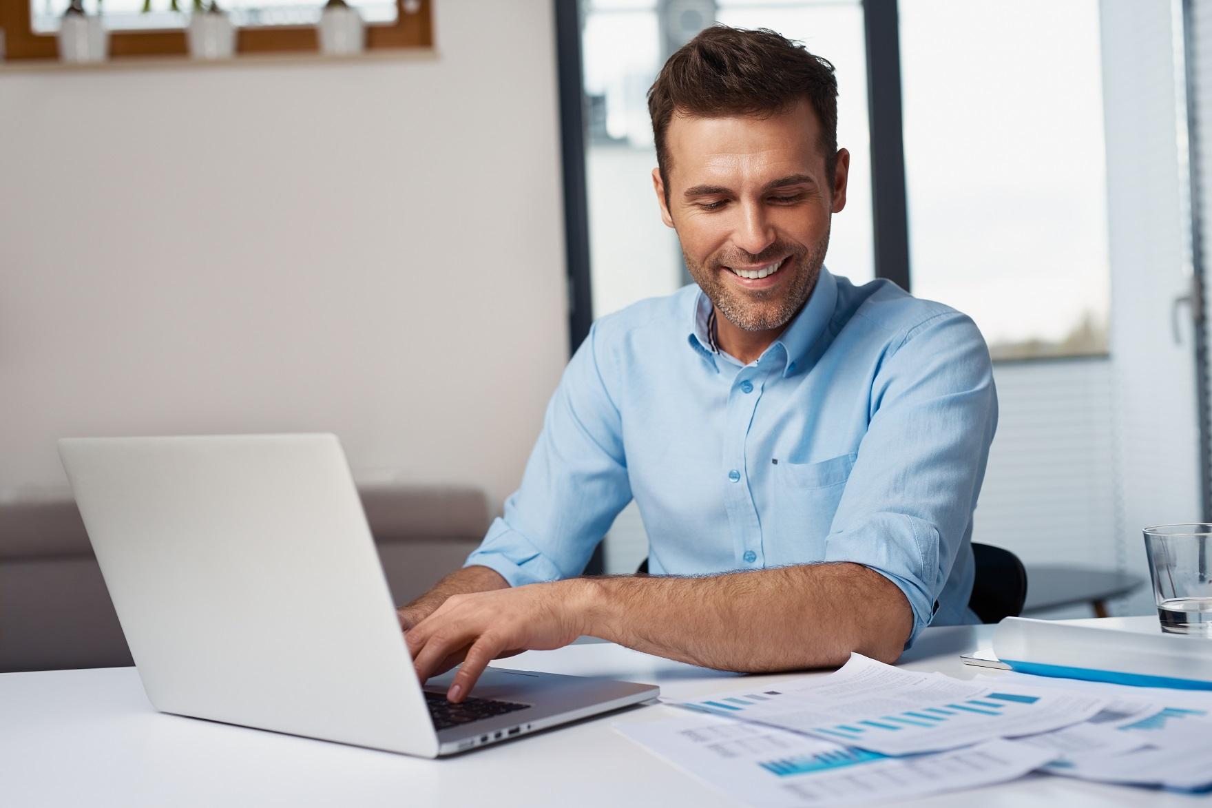 Man doing data entry job at laptop