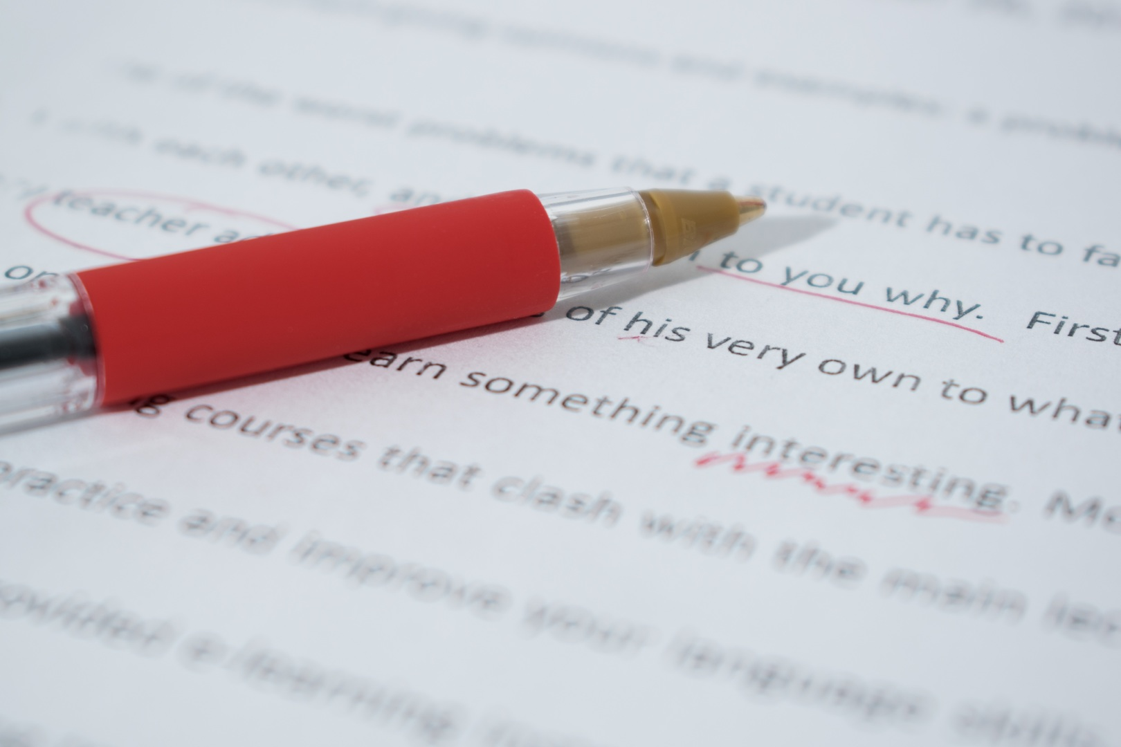 A red pen Lying on a Paper after done with Editing. Content